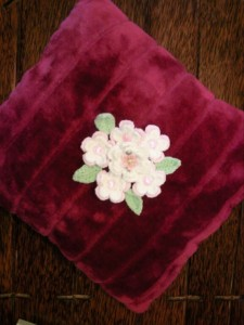 Purchased pillow with crochet flowers