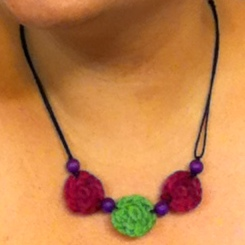 Make a necklace with three crocheted beads and coordinating wooden beads.