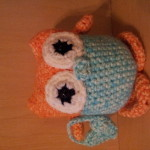 Court's owl has a heart purse - very cute.