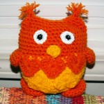 Carole's lovable owl is orange and yellow.