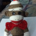 Brenda made a bow tie for her sock monkey.