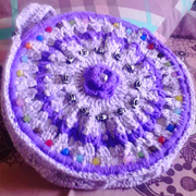 I'm loving the bead work on Faiza's bag.