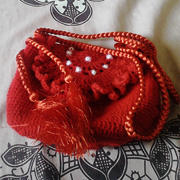 Faiza is on a roll with another crocheted purse.