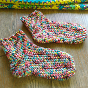 Carol finished a pair of warm socks for the winter.