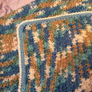 Carol made this blanket with blue and brown yarn.