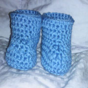 Carol crocheted these little baby booties.