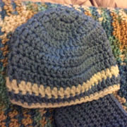 This blue and white striped hat is crocheted by Carol.