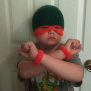 This ninja turtle hat and cuffs are made by Susanne.