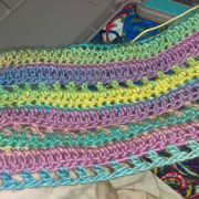 This colorful scarf is finished by Carol.