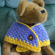 Lillian frogged her sweater and made a cute teddy bear shawl.