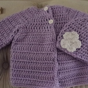 Cynthia crocheted this baby sweater and hat set.