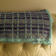 Cynthia finished this plaid crocheted blanket.