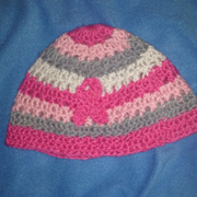 Susanne crocheted this pink hat for breast cancer awareness.