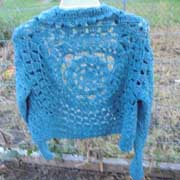 Daelynn finished this lacy blue cardigan sweater.