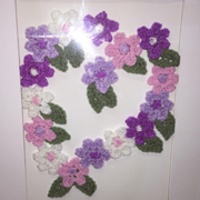 Reana crocheted and framed these flowers.