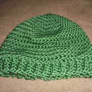 Daelynn crocheted this green hat with a ribbed edging.
