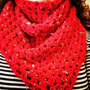 This red shawl was crocheted by Debbie.