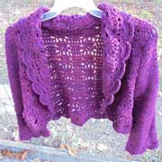 Daelynn finished this purple sweater with a scallop border.