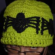 Daelynn crocheted this hat with spider appliques.