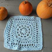 Daelynn crocheted this elegant light blue square.