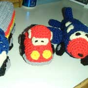 Linda crocheted a toy truck, car and airplane.