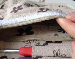 This zippered pocket is great for all of your small crochet notions.
