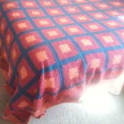 Patricia crochet this pretty afghan with squares.