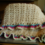 Sandy crocheted this free style baby blanket.