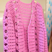 Molly finished this pink cardigan sweater.
