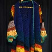 Fiona finished crocheting this coat of many colors.