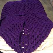 Fiona is working on this purple granny shrug.