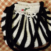 Mary crocheted this black and white striped handbag.