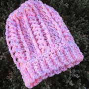 Debbie finished crocheting this pink hat.