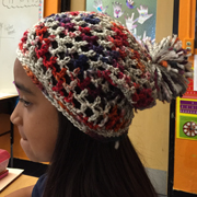 Mali crocheted this multi colored hat with pom pom.