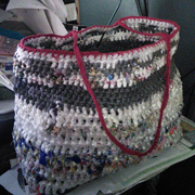 Penny is almost done with her plarn (plastic yarn) bag.