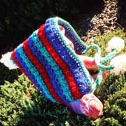 Debbie made this striped hat with pom poms.