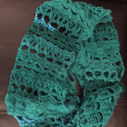 This pretty turquoise scarf is crocheted by Michele.