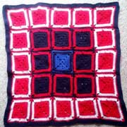 Patricia is working on these squares for a BIG stocking.