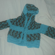 Susanne completed the 5 month old sized cardigan.