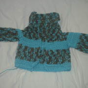 Susanne is working on a 5 month old sized cardigan.