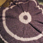 Mary finished crocheting this round afghan.