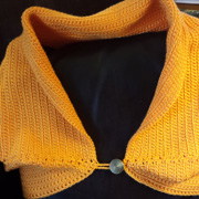 Lee finished crocheting this pretty bolero wrap.
