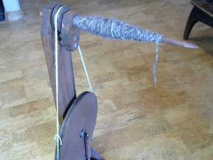 My wheel with red oak finish, spinning my favorite fiber