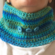 Varsha's cowl has cute blue buttons on it.